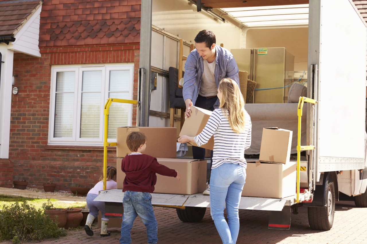 if you're moving to live in spain, you'll need help unpacking boxes like this family