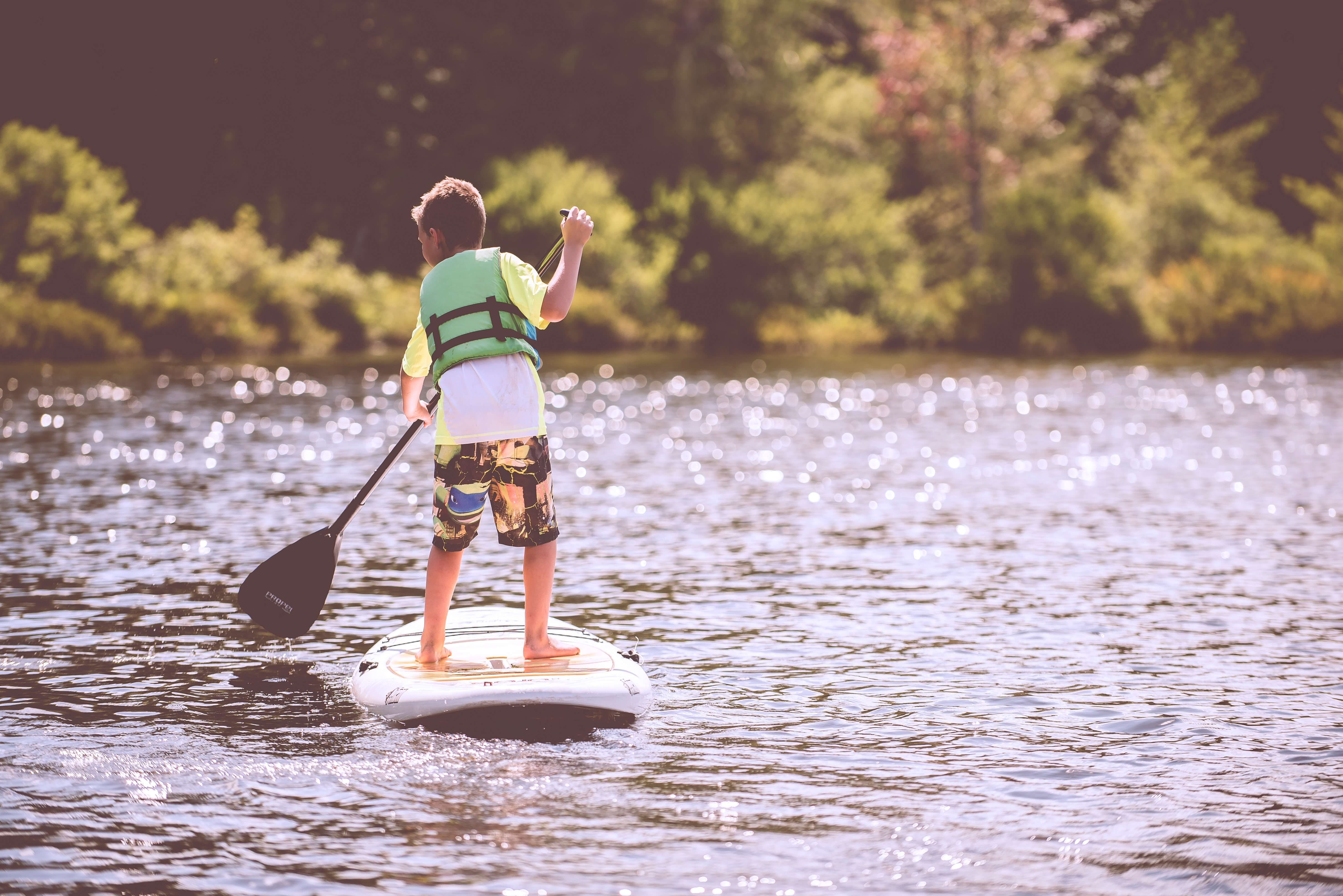 paddleboard is another summer thing to do in spain with kids