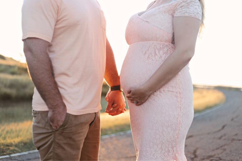 a couple considering purchasing private maternity insurance