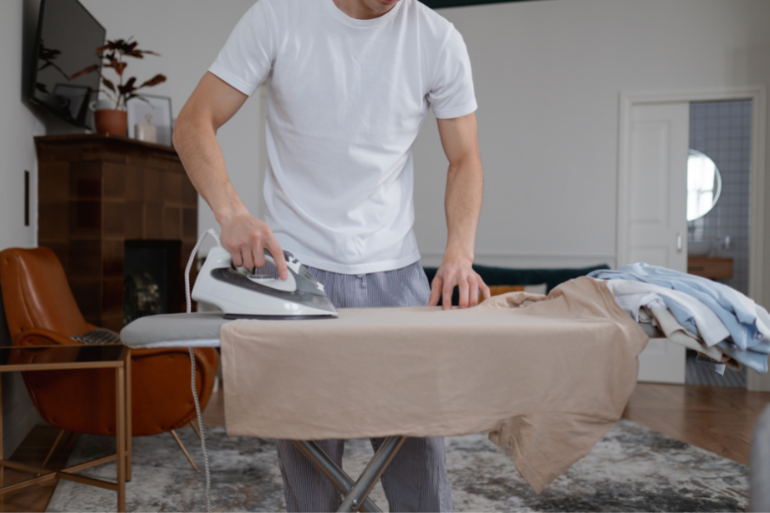 ironing clothes to take in the hospital bag for delivery