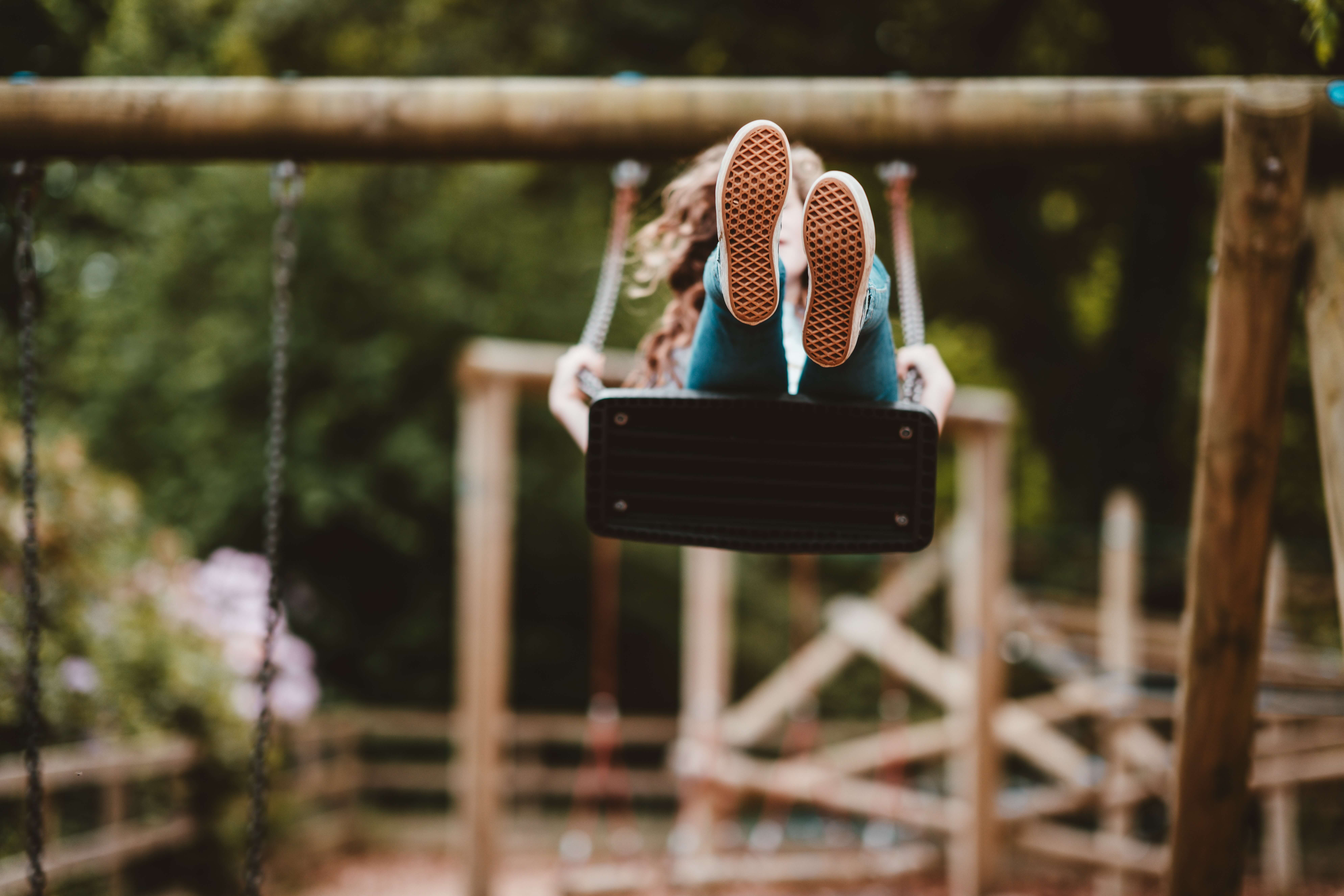 child on a swing carefree due to family insurance plans