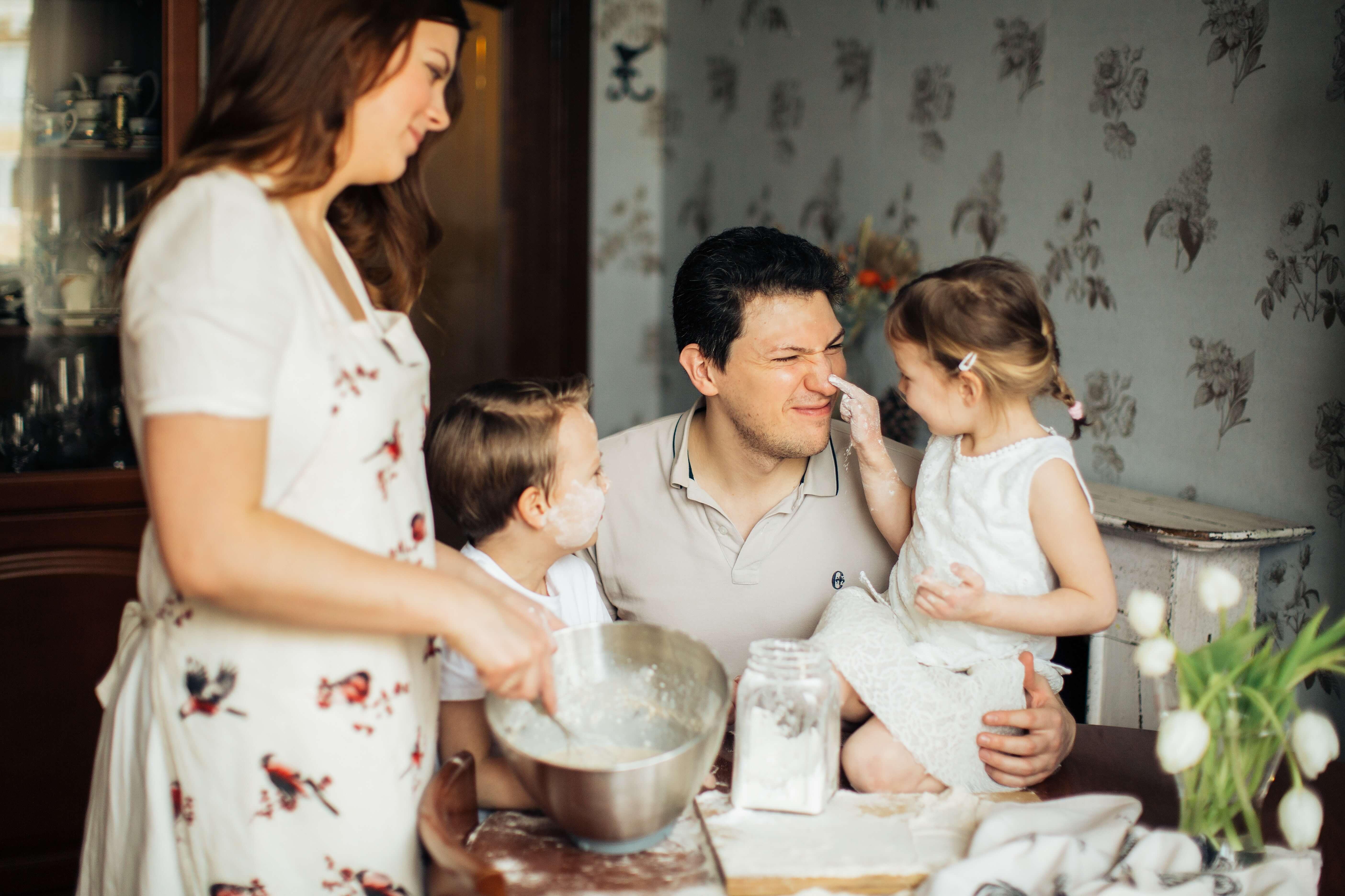 a family making a roscon de reyes in spain
